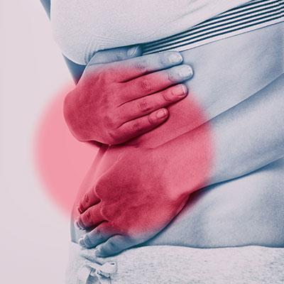 Person holding gut in pain from IBS