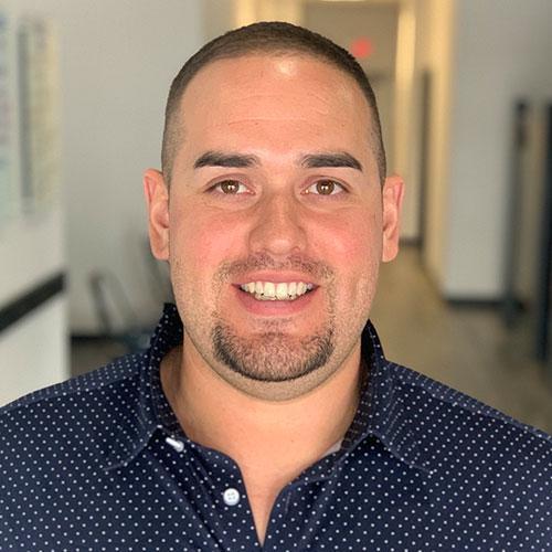 Headshot of Dr. Carlos Sandoval